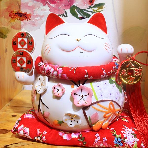 mèo thần tài tặng quà tân gia